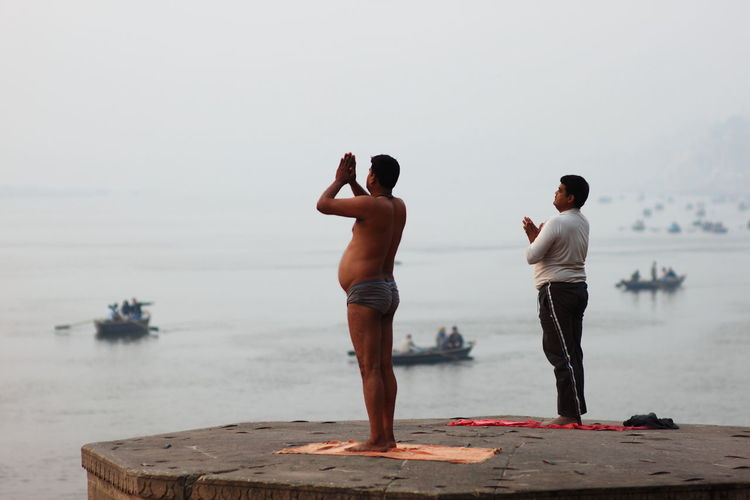 yoga of morning Beach Enjoyment Ganges River India Lifestyles Morning Real People Standing The Ganges River Yoga