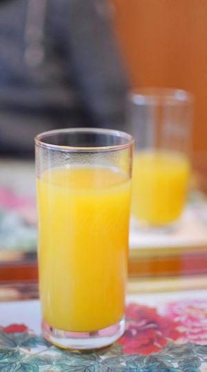 Close-up of orange juice in glass