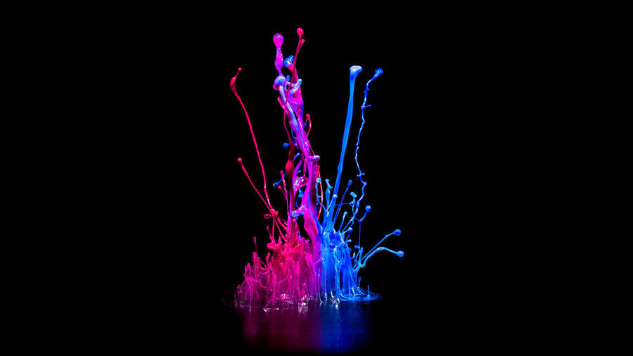 Pink and blue paint splashing on audio speaker isolated on black background Motion Studio Shot Indoors  Black Background No People Splashing Abstract Impact Copy Space Purple Close-up Multi Colored Long Exposure Water Pattern Creativity Nature Pink Color Illuminated Mixing Paint Splash