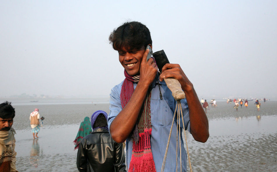 The signal of mobile phone covers and most remote parts of the Sundarbans jungles, West Bengal, India on January 17, 2009. Accessories Away Communication Connected Connection Connectivity Far And Away India Information Isolated Place Jungle Men Mobile Person Phone Remote Sundarbans West Bengal Wireless