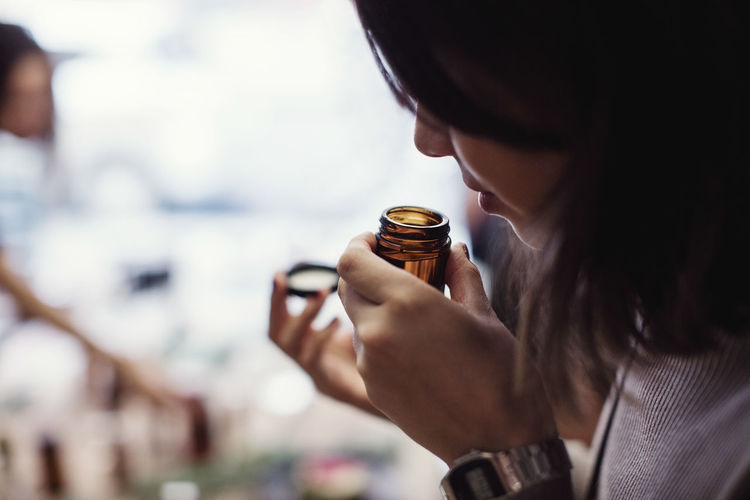 Close-up portrait of woman holding ice cream cone