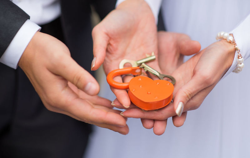 Close-up of young couple with padlock