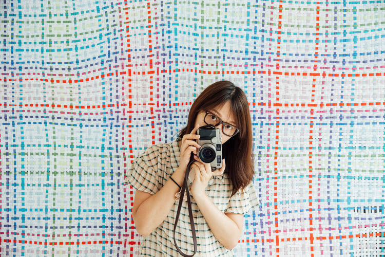 Portrait of a woman photographing