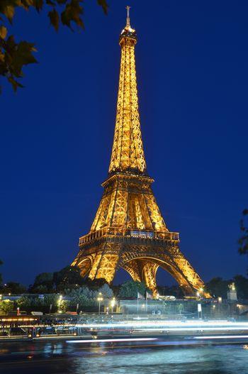 Eiffel Tower Paris Paris, France  Architecture Blue Building Exterior Built Structure City History Illuminated Motion Night No People Outdoors Sky The Past Tourism Tower Travel Travel Destinations Tree