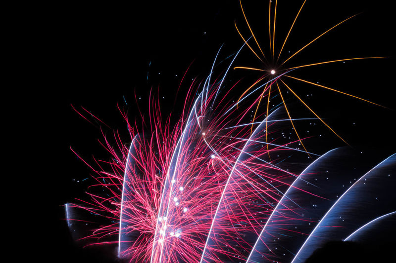 Arts Culture And Entertainment Black Background Blurred Motion Celebration Event Exploding Firework Firework - Man Made Object Firework Display Glowing Illuminated Light Long Exposure Low Angle View Motion Multi Colored Nature Night No People Red Sky Sparks