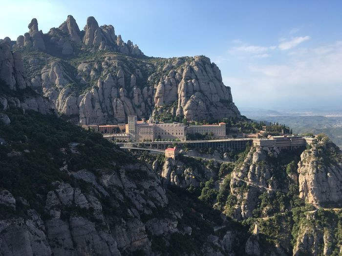 Panoramic view of montserrat rocks and mountains against sky