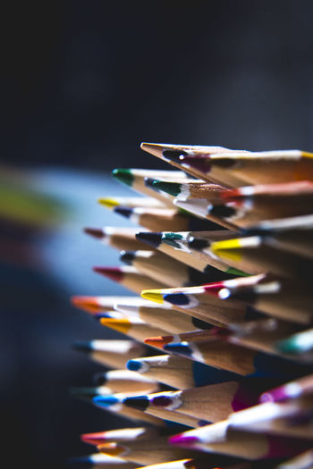 Colourful Abundance Black Background Bunch Of Pencils Choice Close-up Collection Colored Pencil Colorful Equipment Focus On Foreground In A Row Indoors  Large Group Of Objects Multi Colored No People Order Pencil Selective Focus Still Life Studio Shot Table Variation Writing Instrument