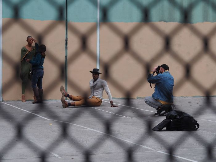 Sport Fence Real People People Men Group Of People Full Length Chainlink Fence Boundary Day Child Childhood Barrier Shadow Playing Competition Sunlight City Leisure Activity Boys Model Photoshoot The Art Of Street Photography