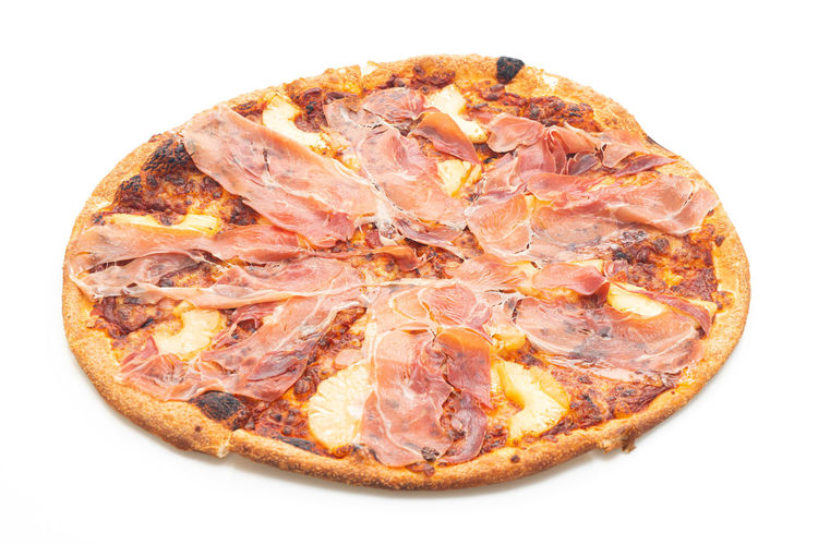 Close-up of pizza against white background