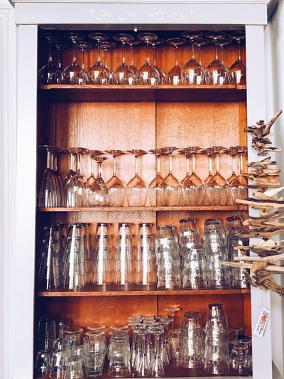 Glasses Arranging In Shelf
