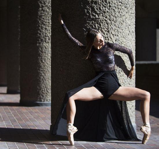 Ballet dancer dancing in city