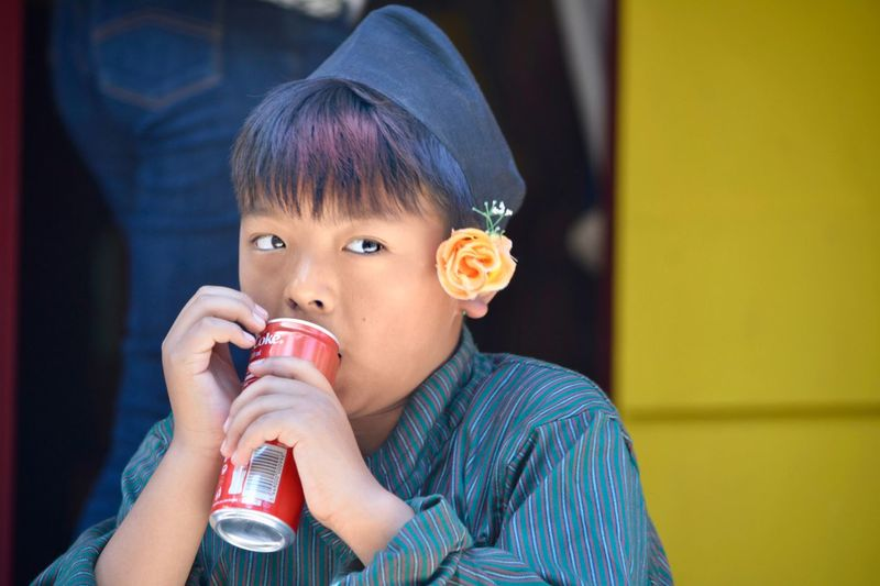 The portraits of this young boy were taken during the festival of Nepal in the big pagoda of Vincennes (France). This young boy participated at Kumari célébration. A silent complicity was established between him and me during which I was able to capture his beautiful expressions of child both candid and malicious. Candid Young Boy Portrait EyeEm Selects Child Food And Drink Childhood Headshot Portrait One Person Drink Lifestyles Refreshment Body Part Human Body Part Looking At Camera Real People Innocence Holding Drinking The Portraitist - 2018 EyeEm Awards