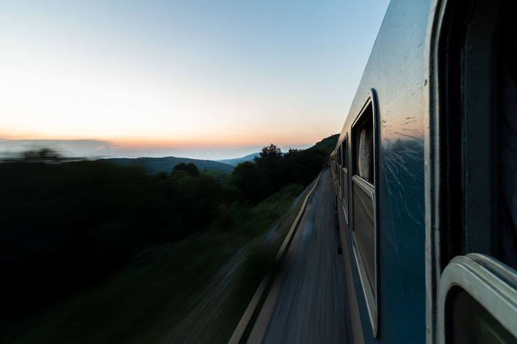Train against sky at sunset