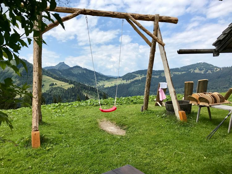 Beauty In Nature Cloud - Sky Day Environment Field Grass Green Color Land Landscape Mountain Nature No People Non-urban Scene Outdoors Plant Scenics - Nature Sky Swing Tranquil Scene Tranquility Tree