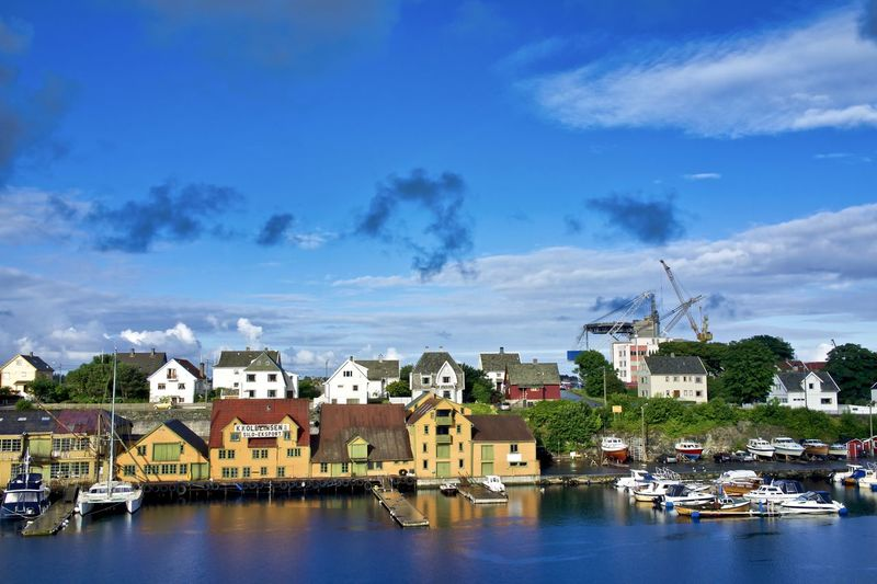 Norway, Haugesund: houses along the canal port Day Daylight Daytime Outdoors House Architecture Cloud Sky Cloudy Water Nobody No One No People Building Exterior Built Structure Building Residential District Cloud - Sky City Nautical Vessel Transportation Nature Mode Of Transportation Town Waterfront Harbor River Cityscape TOWNSCAPE Sailboat Bay Yacht