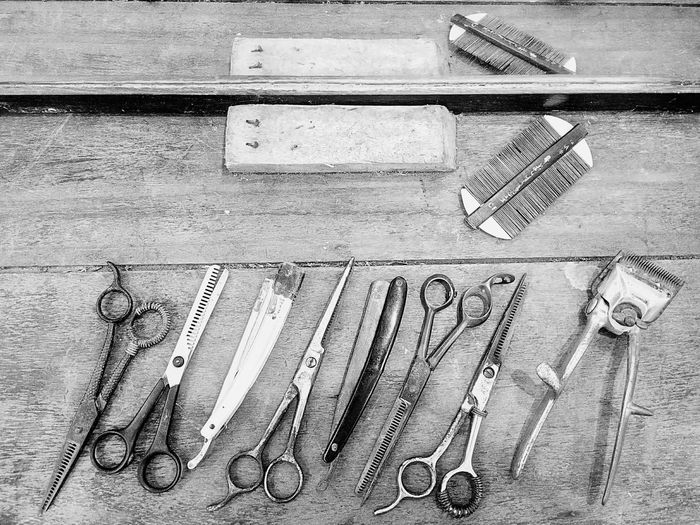 Close-up of barber equipment on table