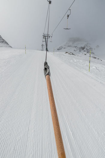 Cold Temperature Winter Snow Mountain Covering Transportation White Color Day Scenics - Nature Cable Car Environment Nature Cable Beauty In Nature Ski Lift Winter Sport Land Sport Non-urban Scene Outdoors Electricity  Snowcapped Mountain Powder Snow