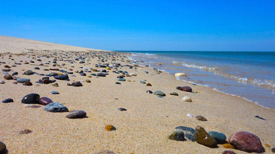 Multi colored pebbles on beach