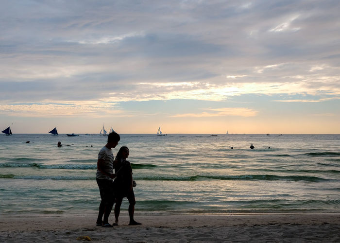 Couple Philippines Beach Beauty In Nature Boracay Cloud - Sky Couple - Relationship Full Length Horizon Horizon Over Water Land Leisure Activity Lifestyles Men Outdoors People Positive Emotion Real People Scenics - Nature Sea Sky Sunset Togetherness Two People Water
