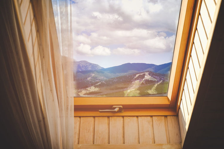 Window Mountain Beauty In Nature Glass - Material Day Mountain Range No People Nature Indoors  Scenics - Nature Sky Transparent Cloud - Sky Wood - Material Tranquil Scene Tranquility Curtain Landscape Sunlight Snowcapped Mountain