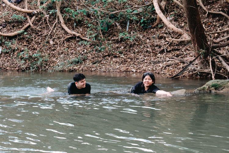 Portrait of people sitting in water
