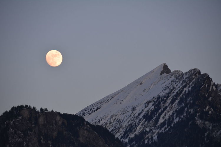 Astronomy Beauty In Nature Clear Sky Cold Temperature Low Angle View Moon Mountain Mountain Range Nature Outdoors Scenics Sky Snow Tranquil Scene