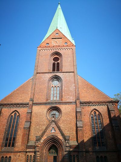 Nikolaikirche Kiel Religious  Religion Christianity Nikolaikirche Kiel Kiel Germany EyeEm Selects Place Of Worship Religion Blue History Clear Sky Spirituality Sky Architecture Building Exterior Built Structure Clock Tower Instrument Of Time Bell Tower - Tower Minute Hand Clock Face Roman Numeral Second Hand Bell Clock Wall Clock Clock Hand