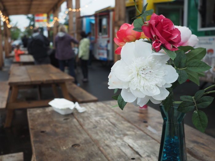 Architecture Beauty In Nature Close-up Day Flower Flower Head Focus On Foreground Food Cart Fragility Freshness Incidental People Nature Outdoors Table Wood - Material