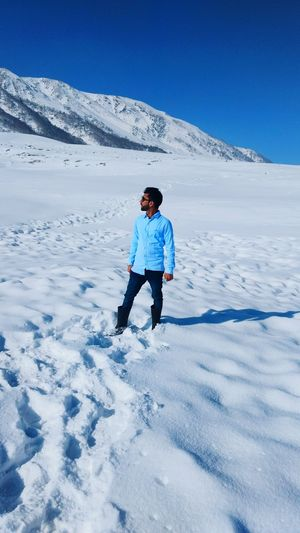 Full length of man on snow covered landscape
