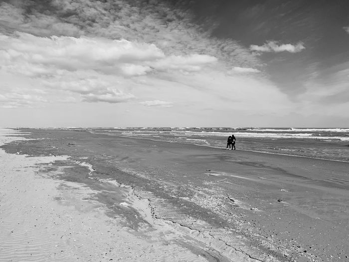 clouds Sea Beach Land Water Sky Horizon Over Water Scenics - Nature Horizon Beauty In Nature Tranquil Scene Cloud - Sky Non-urban Scene Real People Sand
