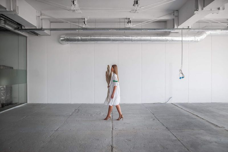 One Person Real People Full Length Architecture Wall - Building Feature Adult Standing Built Structure Building Women Lifestyles Casual Clothing Day Front View Technology Illuminated Indoors  Ceiling The Minimalist - 2019 EyeEm Awards