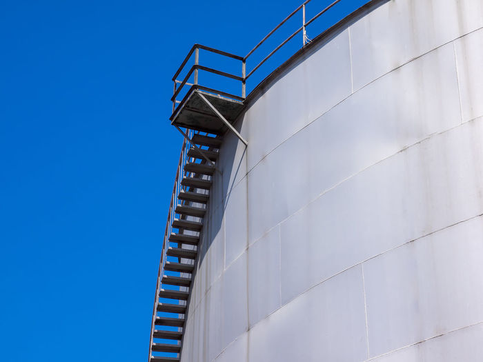 Low angle view of staircase on storage tank