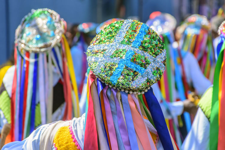 Men dressed in colorful clothes and hats attending a popular religious festival in Minas Gerais, Brazil Carnival Fashion Shine Tradition Art And Craft Brazilian Clothes Clothing Colorful Creativity Culture Dancers Day Fashion Festival Multi Colored Parade Party Patern People Performance Personal Accessory Selective Focus Traditional Variation