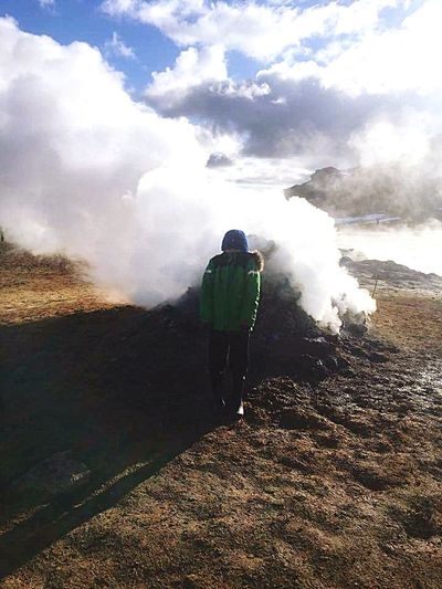 standing in front of steam from the earth Full Length Men Mountain Adventure Hot Spring Rear View Water Volcanic Landscape Smoke - Physical Structure Steam