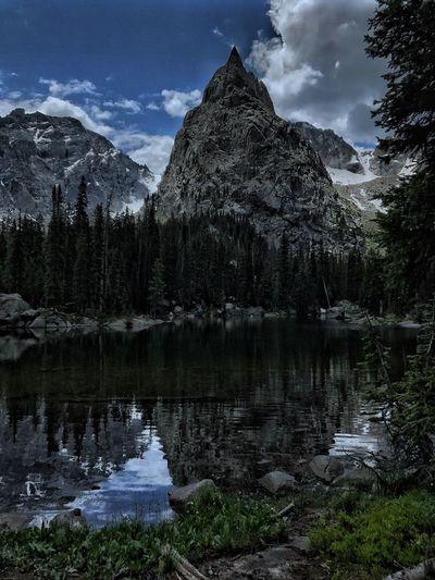 Idyllic shot of lone eagle peak by lake