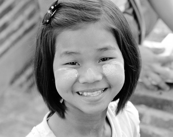 Happy face of a little girl during the sunset in Bagan, Myanmar - Faces of Myanmar - Real People Childhood Focus On Foreground Girls Close-up Blackandwhite Looking At Camera One Person Portrait Headshot Outdoors Smiling Happiness ASIA Human Face Travel Trip Simplicity Myanmar Capture The Moment Beauty Smile Happy Girl Snap A Stranger