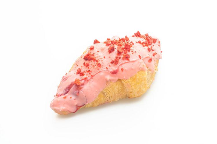 Close-up of ice cream over white background