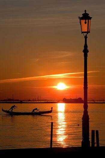 Sunset Water Sky Orange Color Nautical Vessel Beauty In Nature Silhouette Sea Outdoors Sun