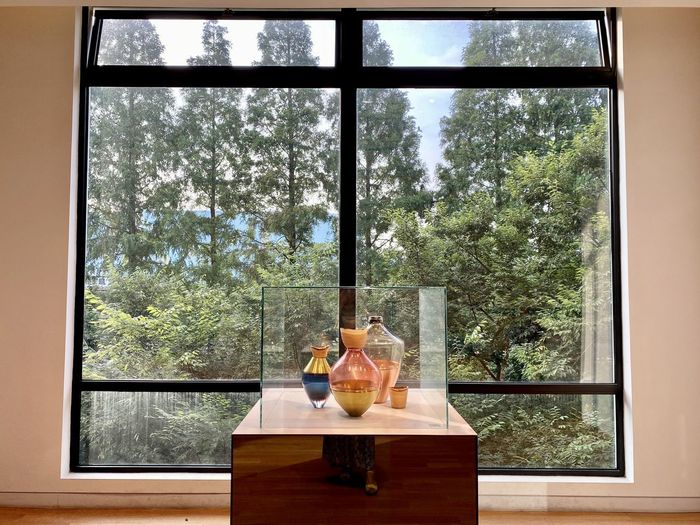 View of wine glass on table against window