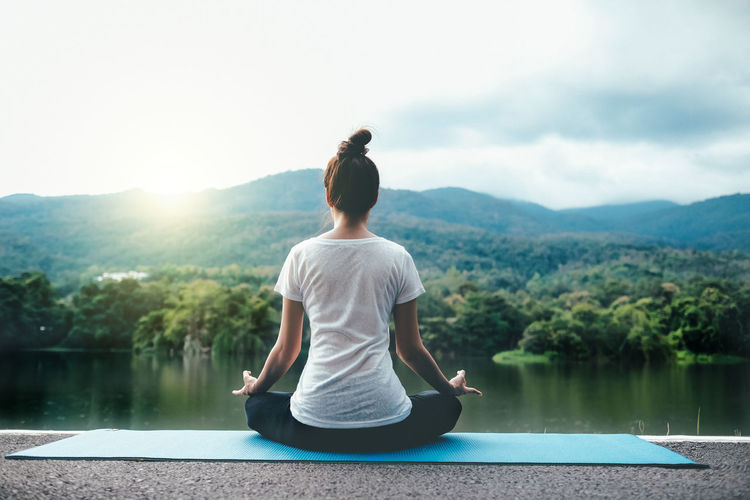 Beauty In Nature Cross-legged Exercising Healthy Lifestyle Lake Leisure Activity Lifestyles Meditating Nature One Person Posture Relaxation Exercise Scenics - Nature Sitting Sport Tranquil Scene Tranquility Water Wellbeing Yoga Zen-like