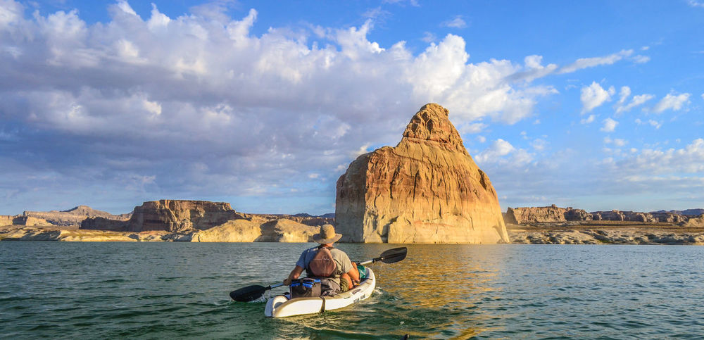 Kayaking In Nature Lake Powell Lone Rock Lonely Page Arizona Utah Adults Only Beauty In Nature Cloud - Sky Day Lone Men Mountain Nature Nautical Vessel One Man Only One Person Outdoors Real People Rock - Object Scenics Sitting Sky Sunrise Water
