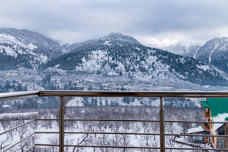 Mesmerizing view of manali from a hotel balcony after heavy snowfall