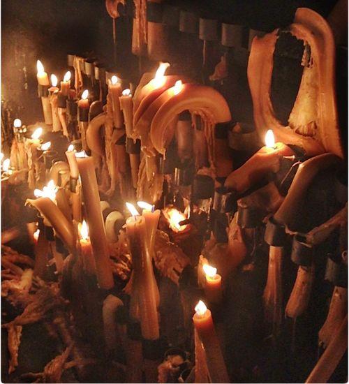 Burning candle in dark room