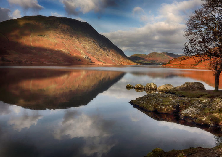 Mountain reflections in Crummock Water Bright Calm Crummock Water Cumbria England UK English Lake District Peace Tranquility Beauty In Nature Cloud - Sky Day Lake Mountain Nature No People Outdoors Reflection Reflections Scenics Sky Tranquil Scene Tranquility Water Waterfront
