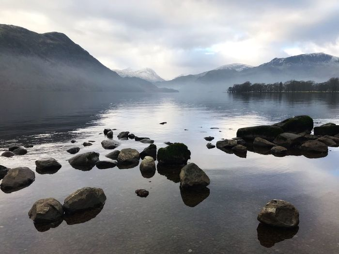 Visitengland Cumbria Lakedistrict Ullswater Nationaltrust Water Sky Cloud - Sky Beauty In Nature Rock Scenics - Nature Solid Reflection Tranquility Rock - Object Tranquil Scene Mountain Nature No People Lake Day Non-urban Scene Idyllic