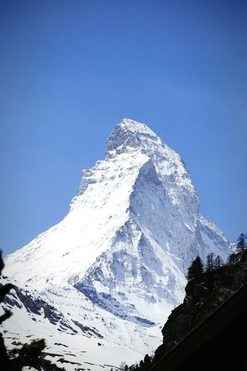 The mountain Cervino Matterhorn  Mountain Alps Huge Switzerland Zermatt Landscape Sky Snow Ice Rocks Cervin Mount