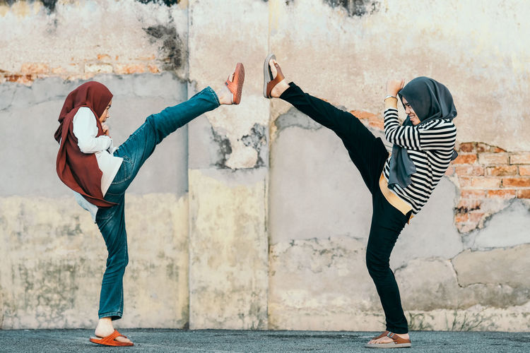 Aggression Girl Power Gritty Women Aggression  Martial Arts Woman In Hijab Woman Power Action Defence Defences Full Length Leisure Activity Lifestyles Self Defence Side View Togetherness Two Girls The Portraitist - 2018 EyeEm Awards International Women's Day 2019