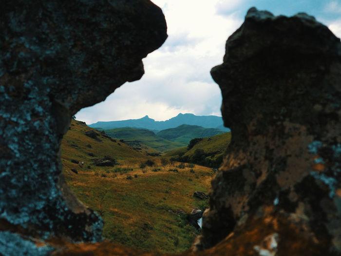 View through stone formation on drakensberg mountains