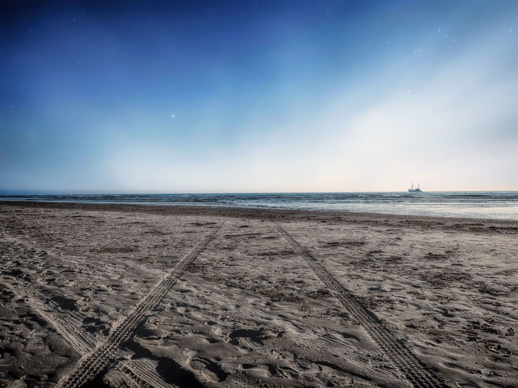 Traces Landscape Photography NatureIsBeautiful Summer Views Astronomy Beach Beauty In Nature Blue Sky Day Horizon Horizon Over Water Landscape Nature No People Outdoors Sand Scenics Sea Ship Sky Traces Traces In The Sand Tranquil Scene Tranquility Water