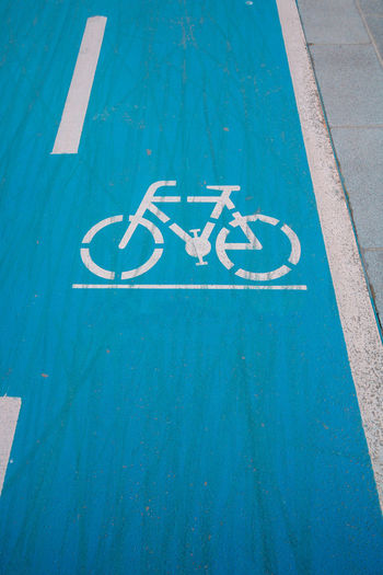 Bicycle lane or bike road sign on blue background.